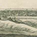 Etching of town in middle distance with star shaped earthworks to the right and large building to the left.