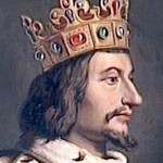 Side portrait of man wearing ornate gold crown.