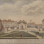 Gatehouse with surrounding buildings and garden.